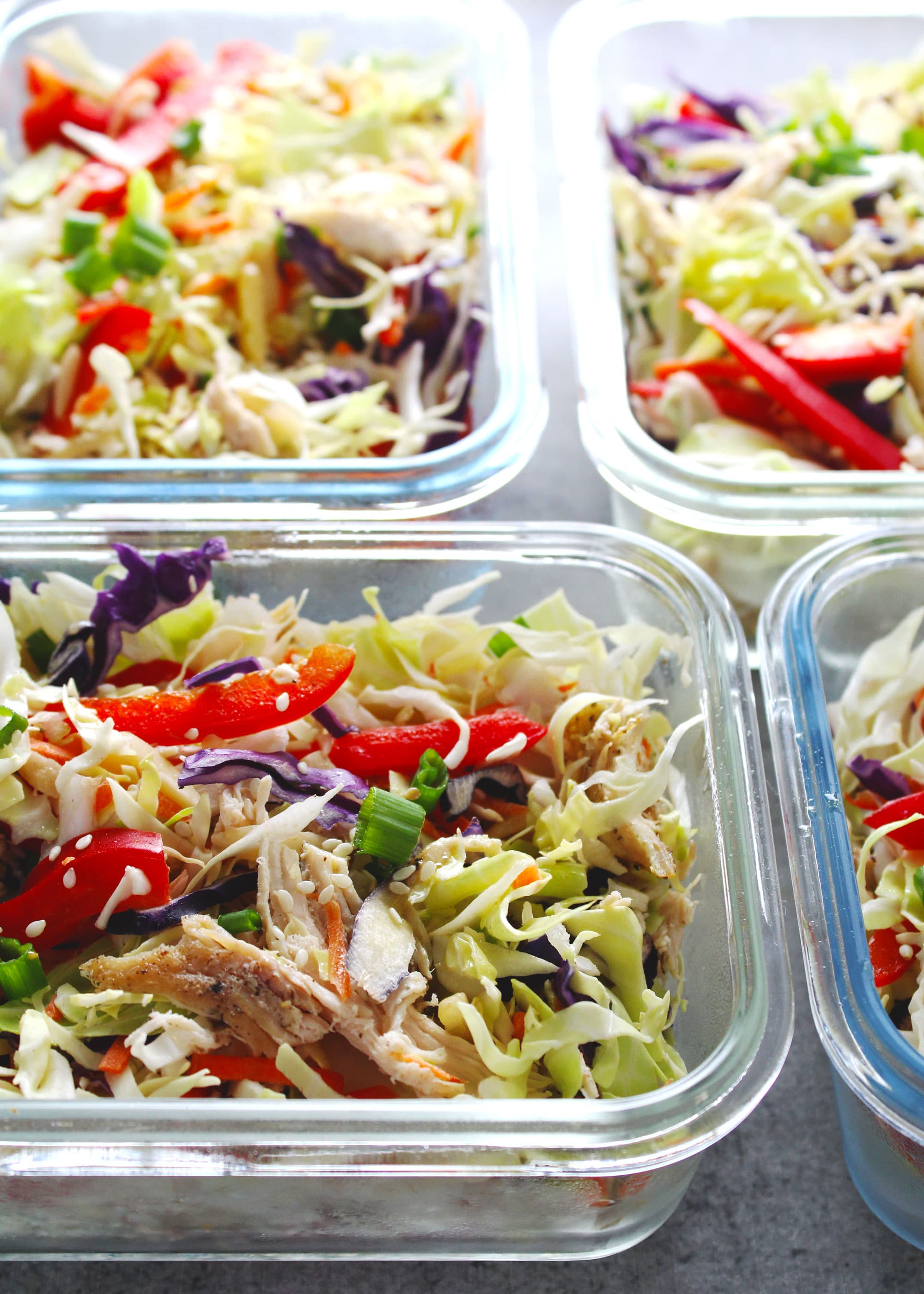 Asian chicken chopped salad in glass containers.