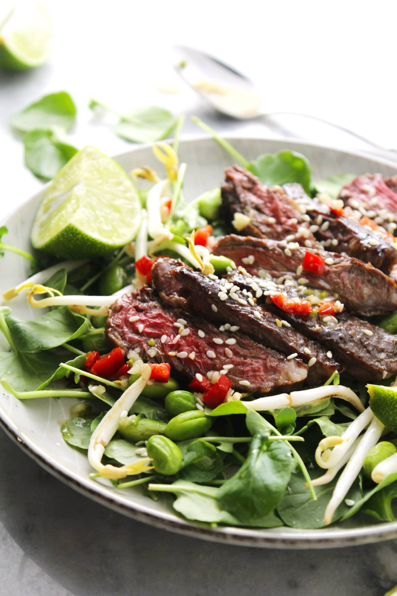 Korean BBQ Steak Salad on gray dish