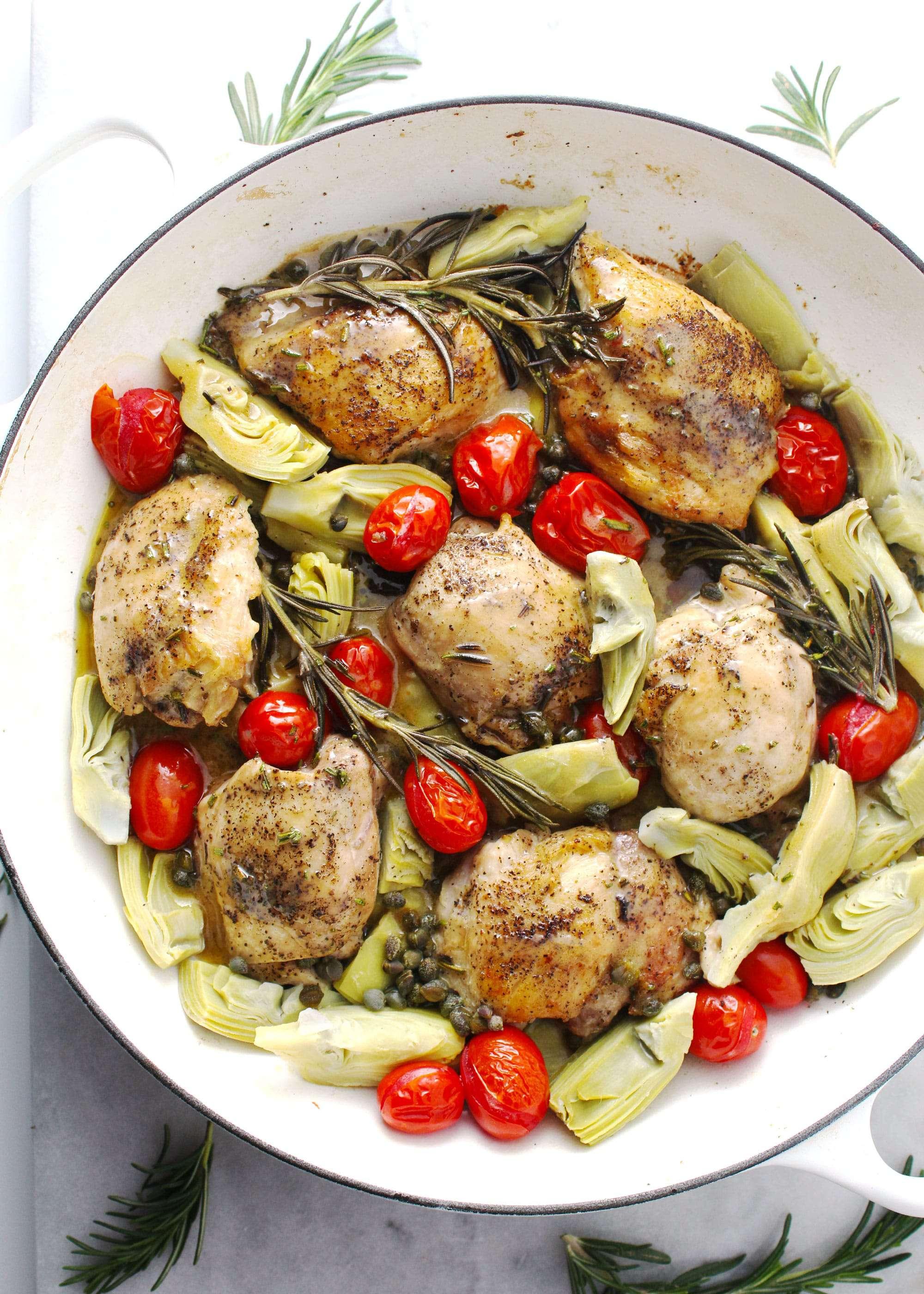 Charred Rosemary Vinaigrette Chicken in a white le cruest pan