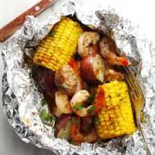 Foil packet Low Country Boil sitting on a marble surface.