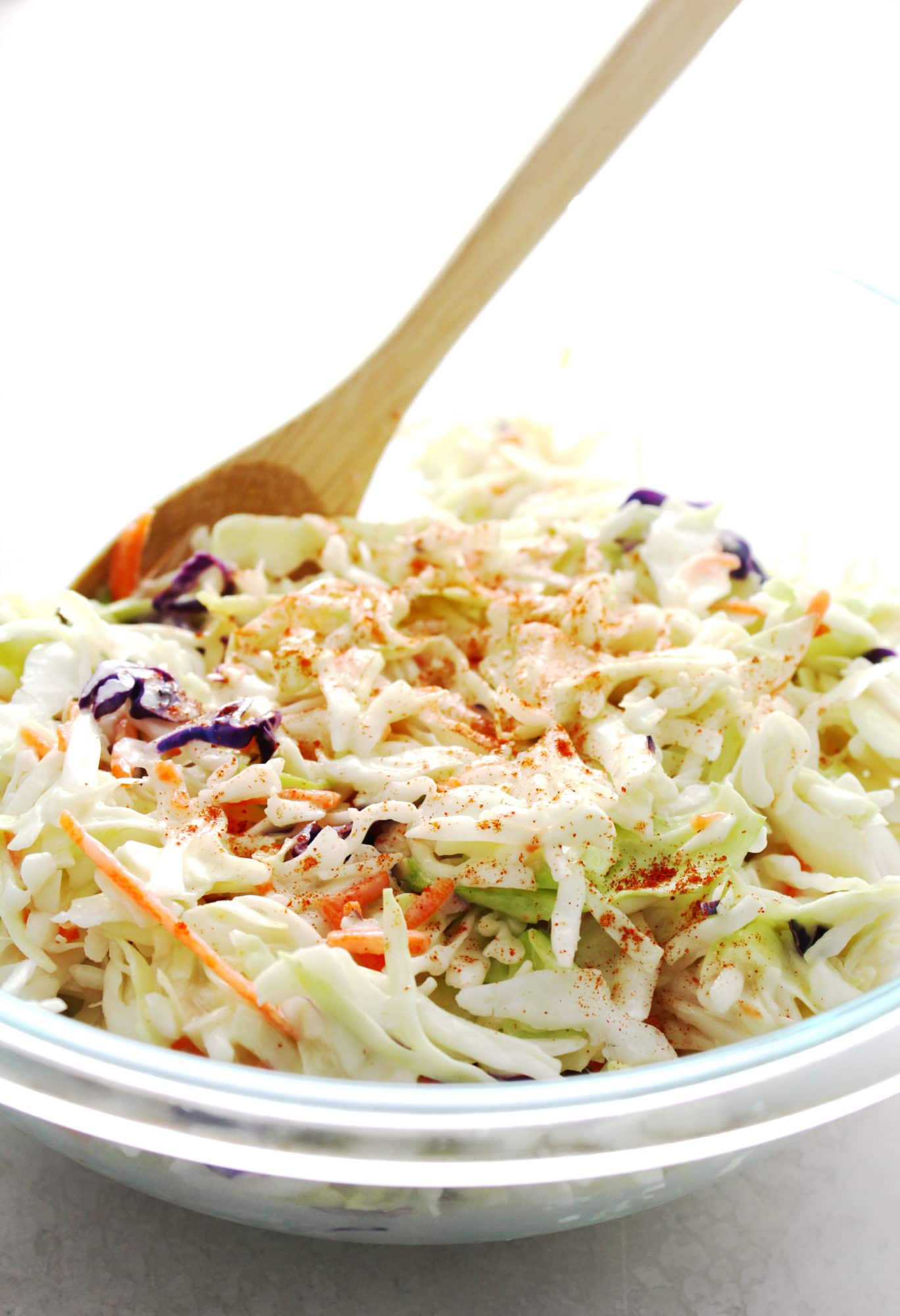 coleslaw in a clear glass bowl