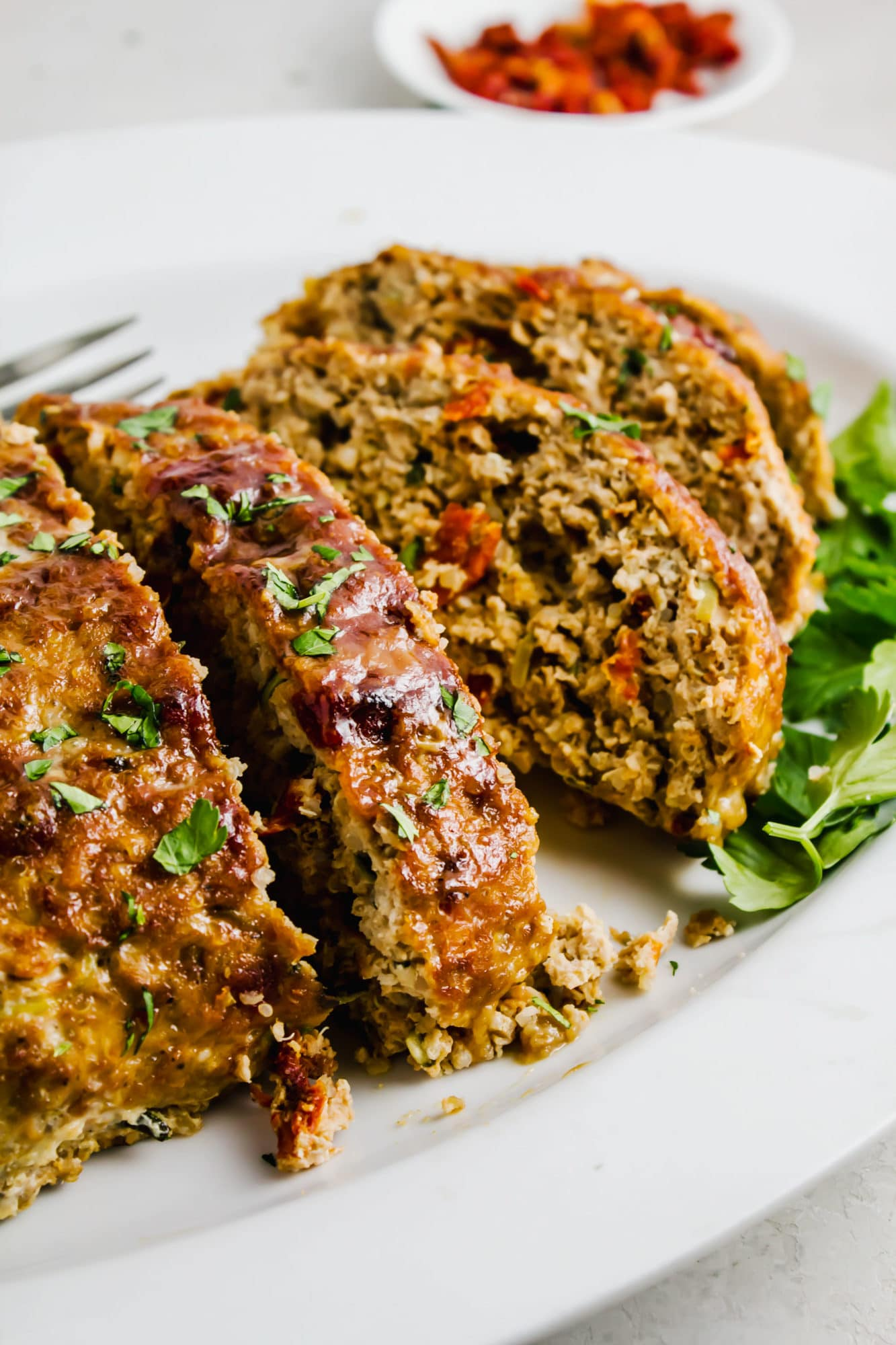 chicken quinoa meatloaf slices on white plate