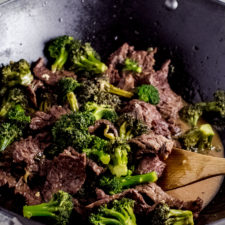 beef and broccoli stir fry in wok