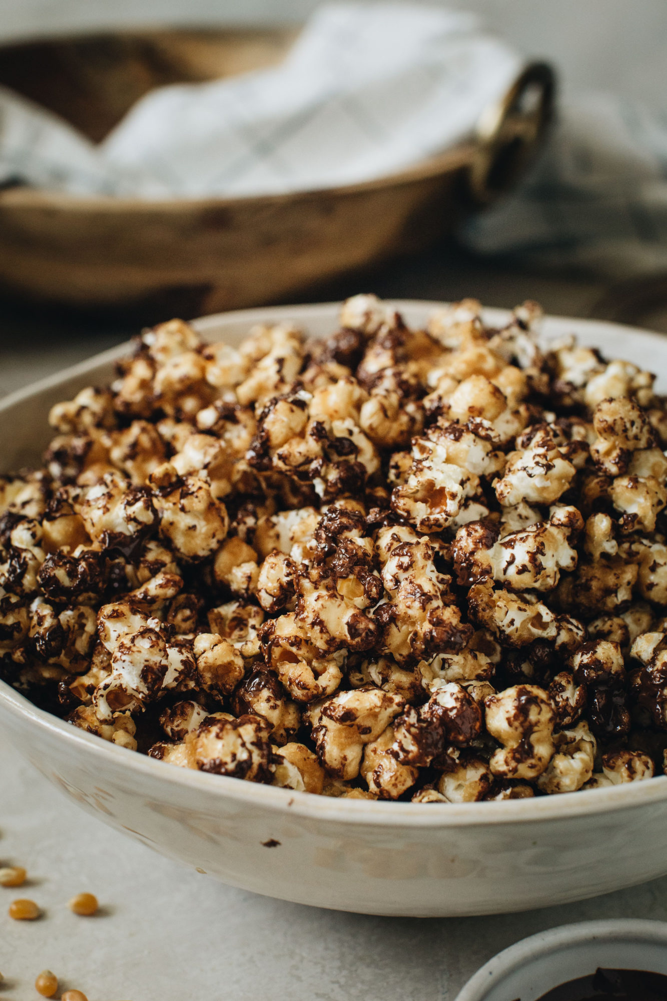 chocolate caramel popcorn in white bowl