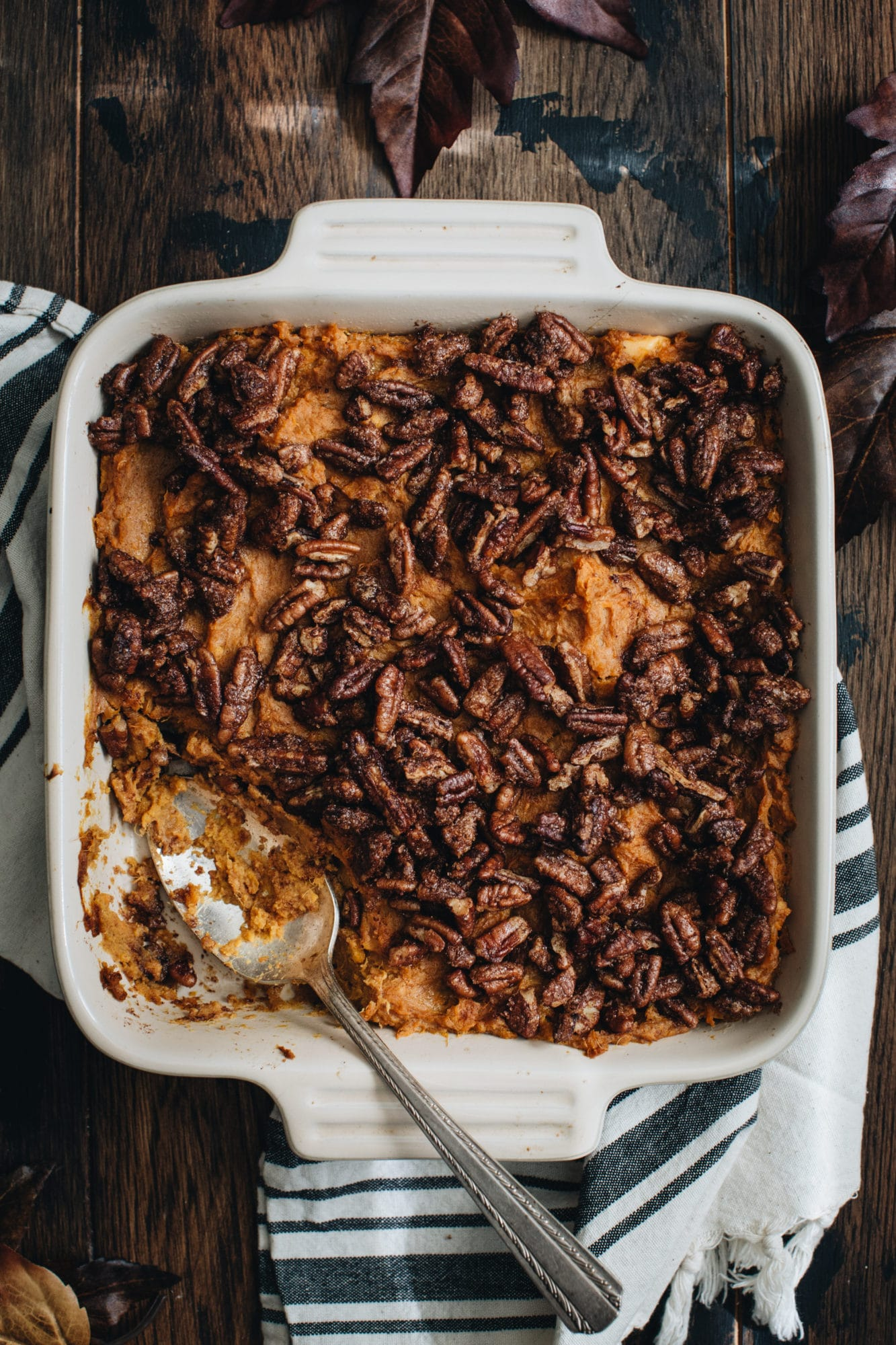 healthy sweet potato casserole with silver spoon