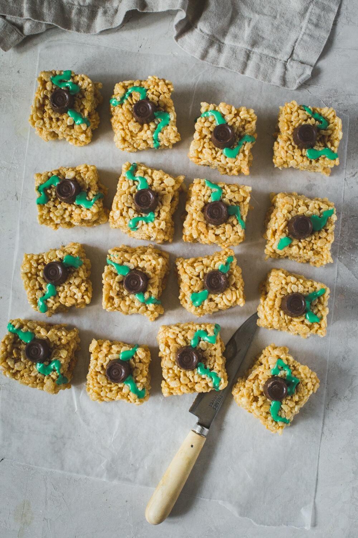 Halloween Rice Krispie Treats shaped like square pumpkins with a Rolo's stem