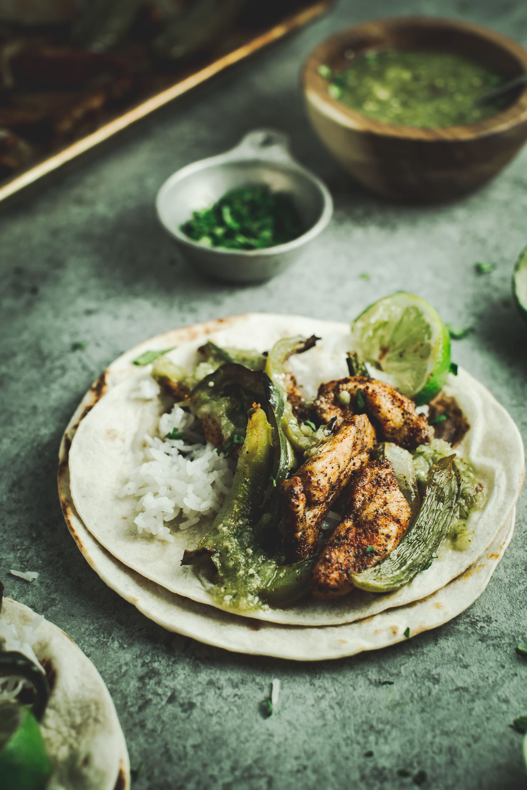 verde chicken fajita with rice and lime on side