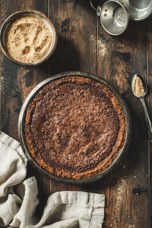 fudge pie in metal pan with graham cracker crumbs