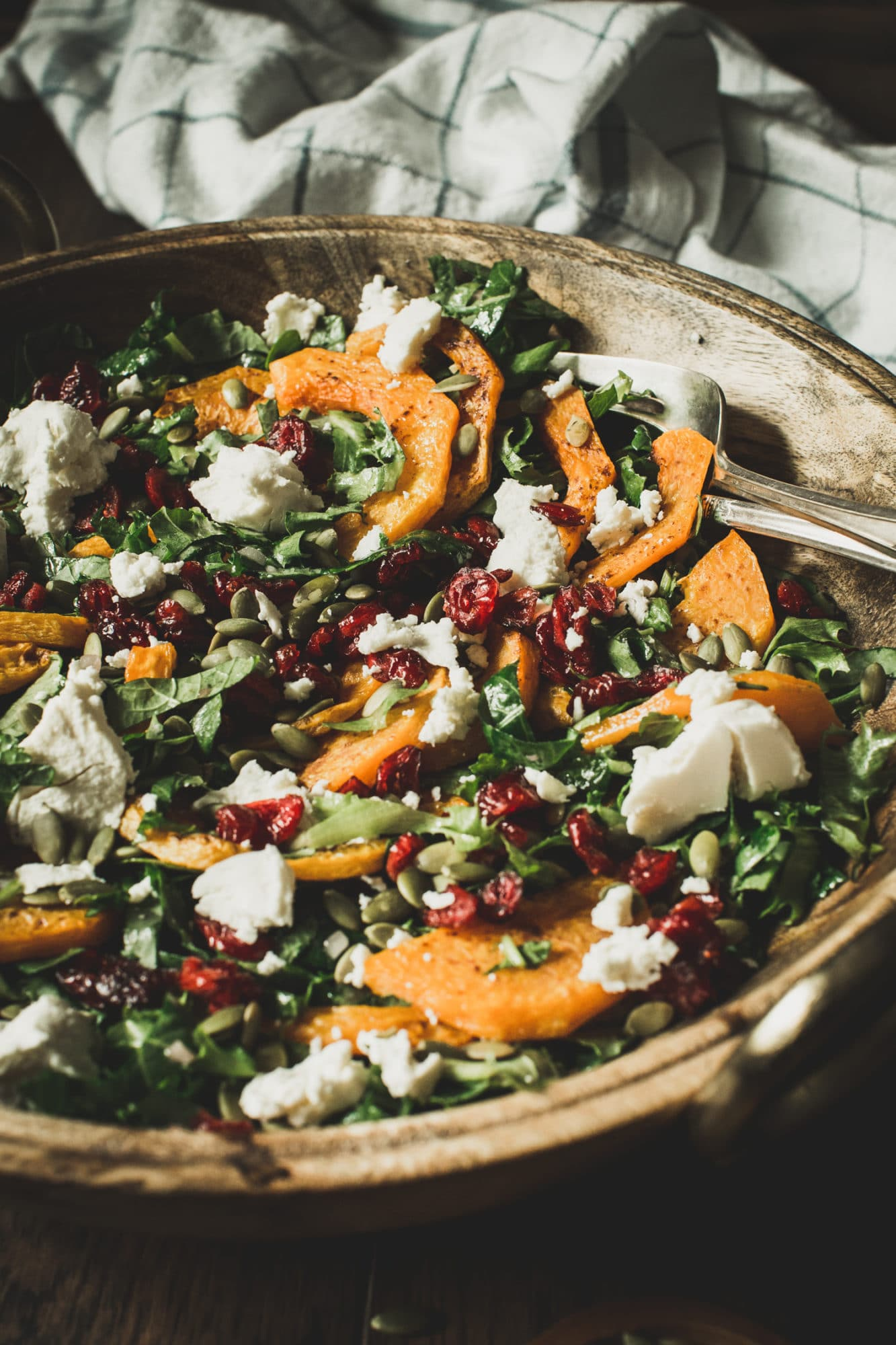 butternut squash salad side view in a wooden bowl