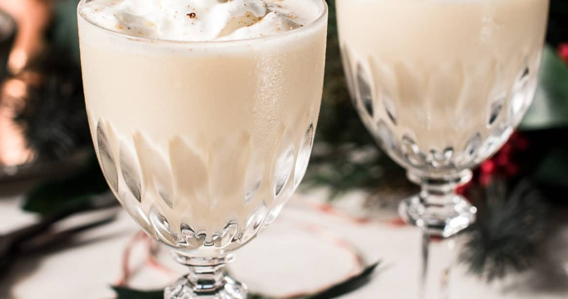 eggnog martini in crystal glasses with whipped cream