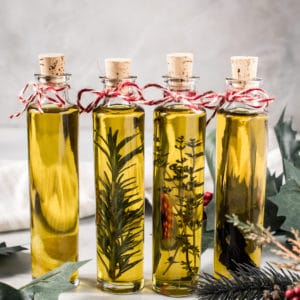 Infused olive oils in glass bottles with cork stopper.