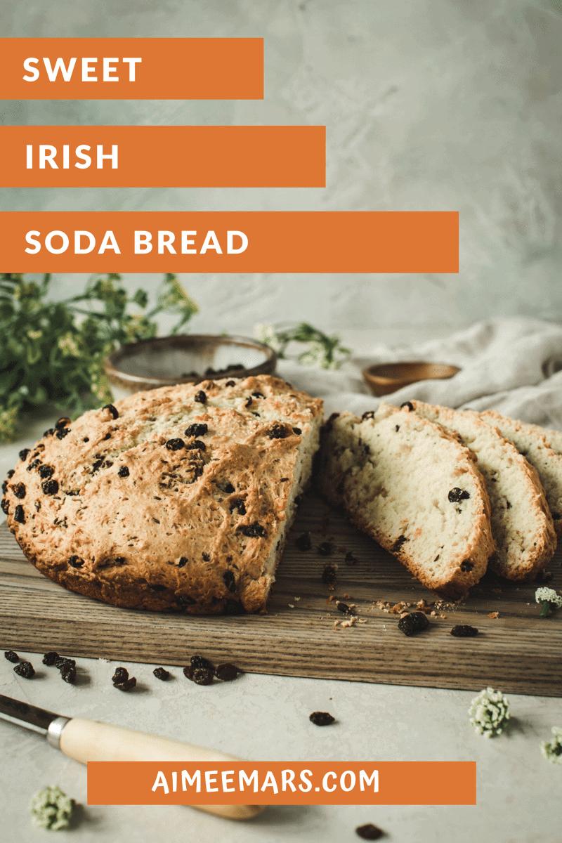 Irish soda bread sliced on a cutting board.