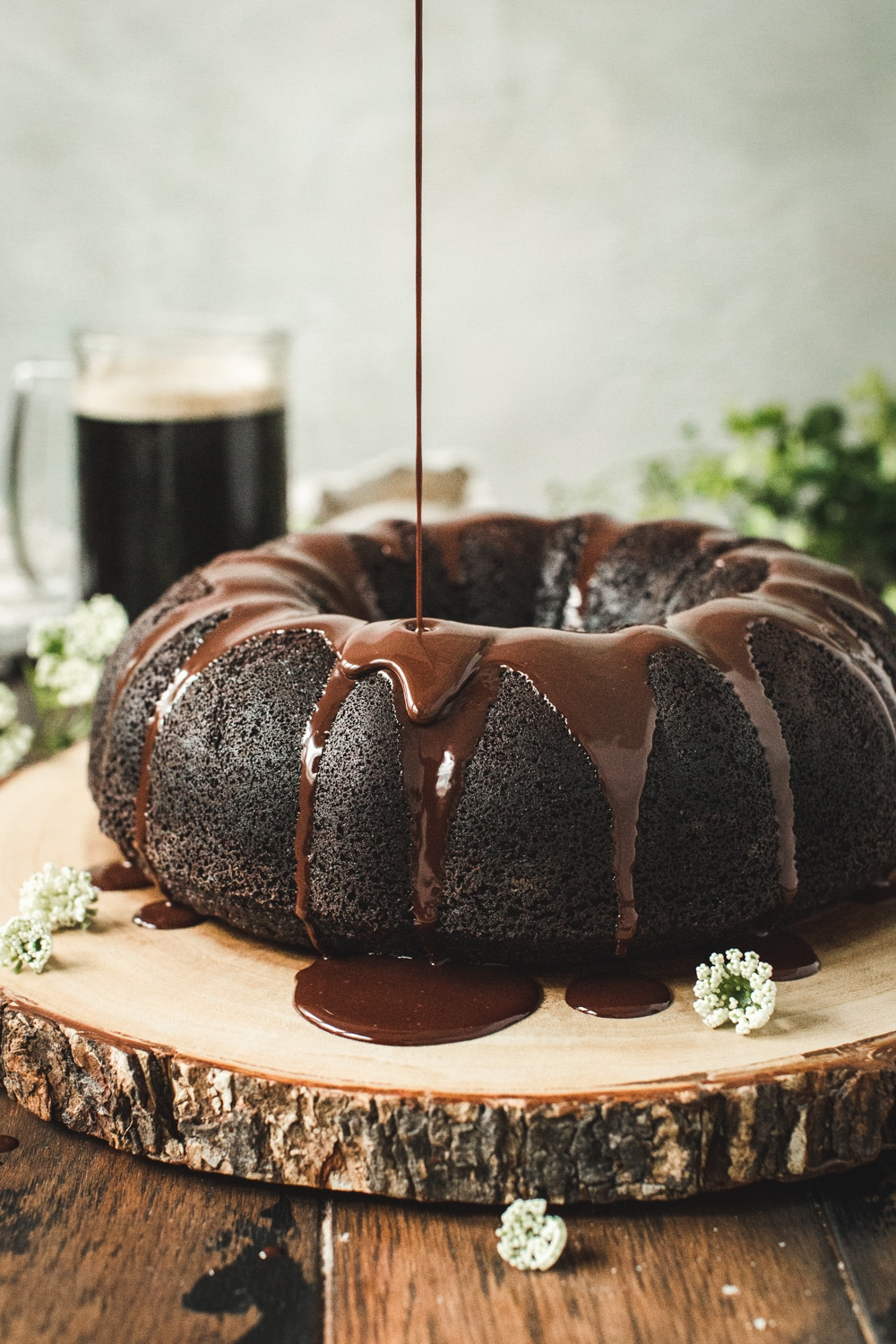 Chocolate Stout Bundt Cake with Chocolate Ganache being drizzled on top