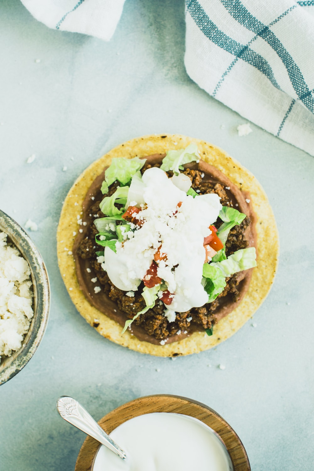 cheese and sour cream layer of Ground Beef Tostadas