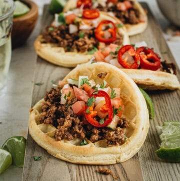 ground beef waffle taco topped with pico de gallo