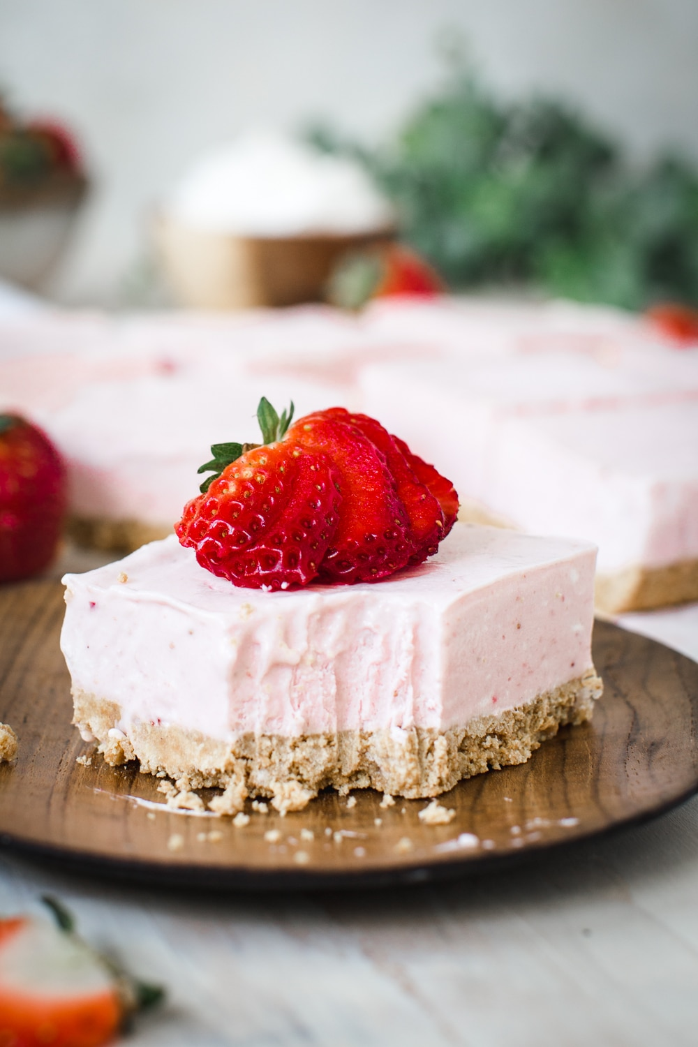 Strawberry Cheesecake Bar with slice cut out