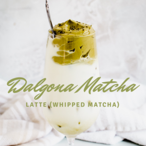 whipped matcha latte with green lettering