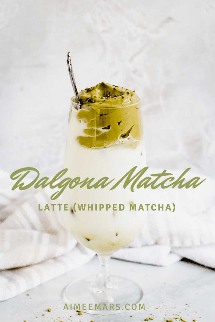 Whipped matcha latte with green lettering.