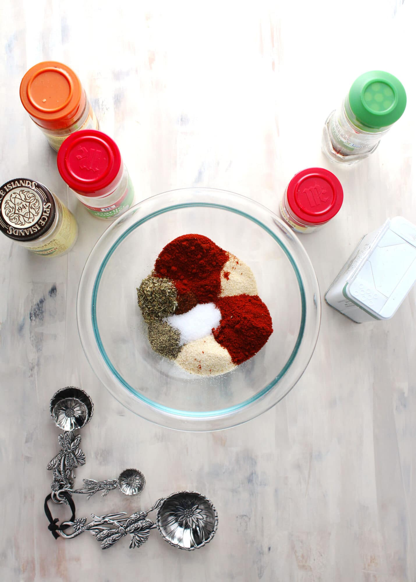 spice ingredients for blackened seasoning in glass bowl