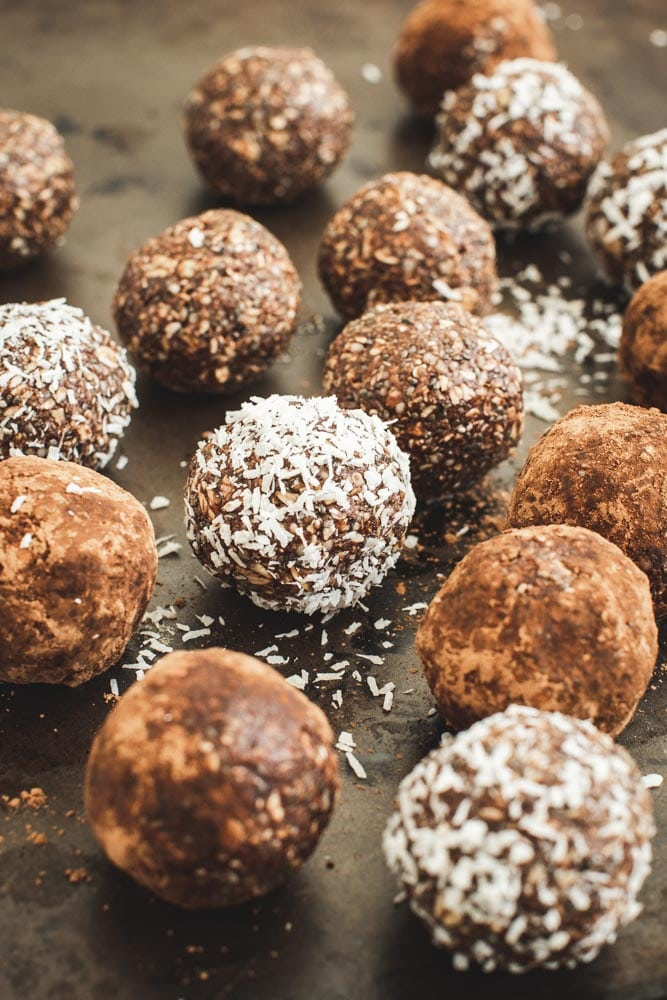 coconut energy balls covered in cocoa and coconut flakes