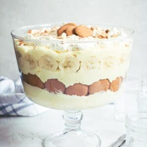 Easy banana pudding layered in clear glass dish.