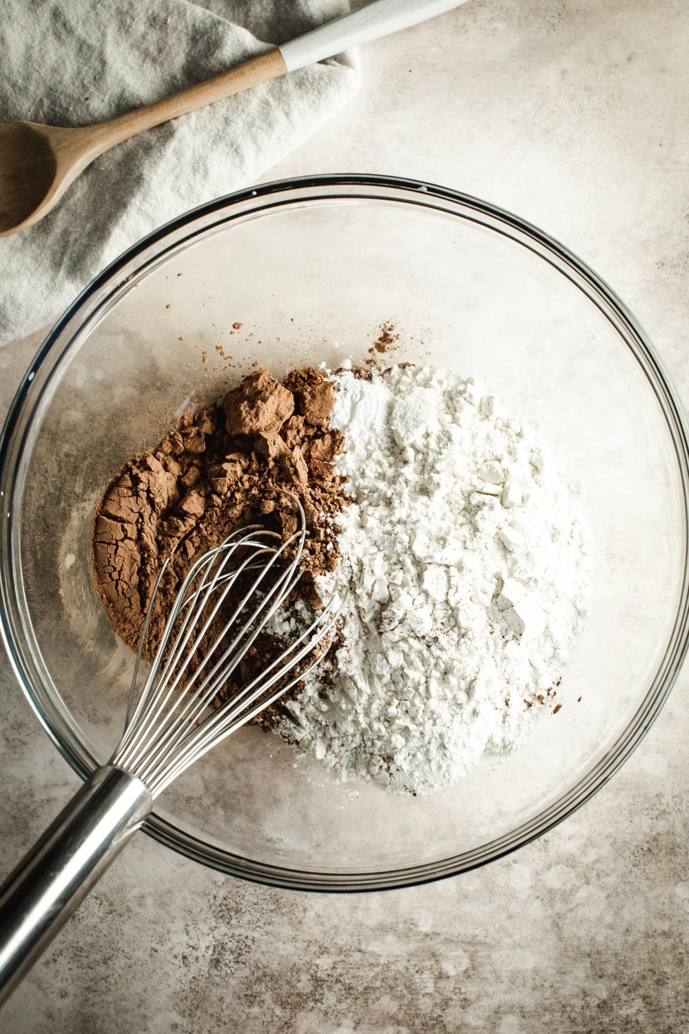 Chocolate banana bread dry ingredients in a mixing bowl with a wire whisk.