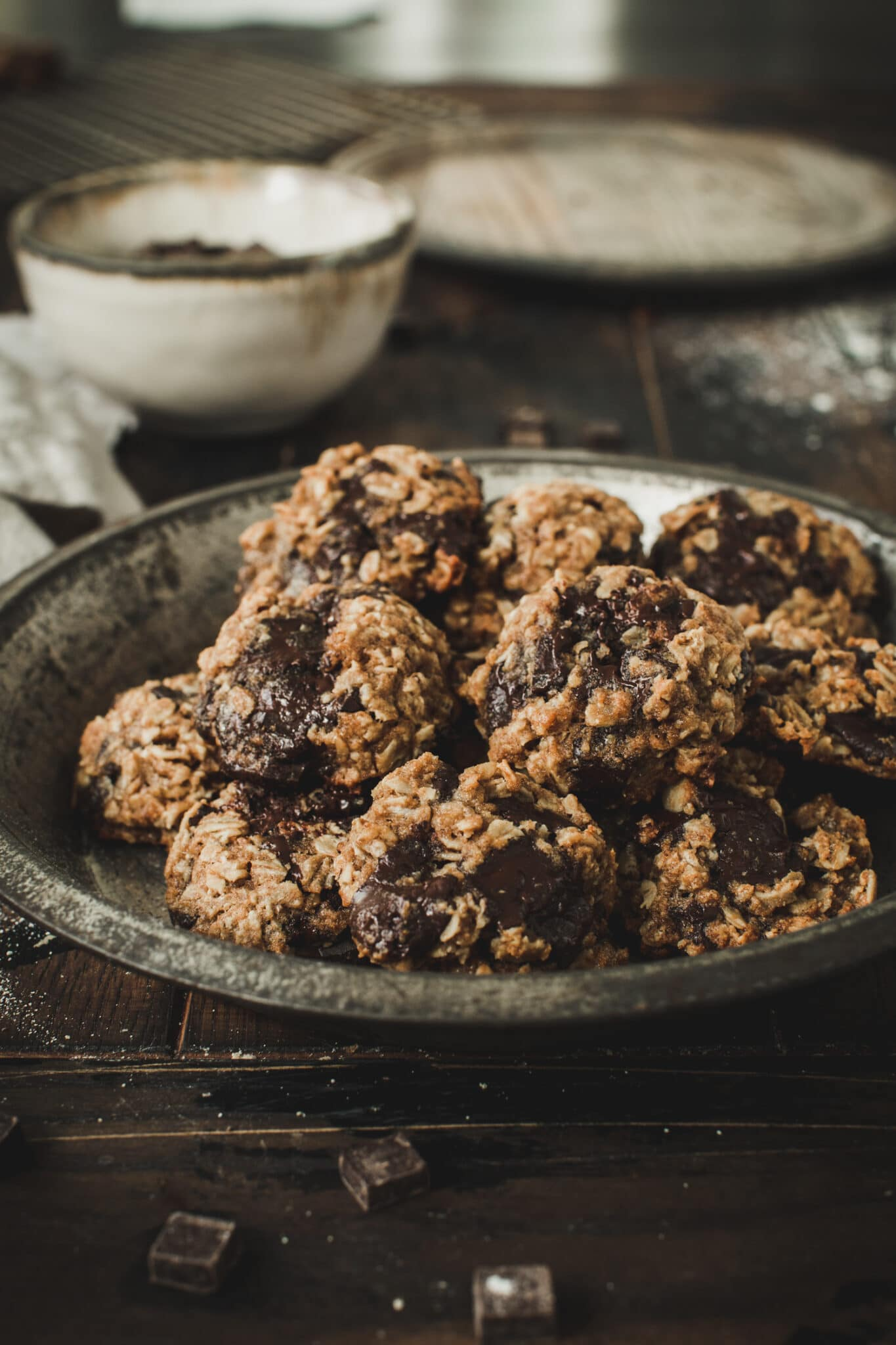 oatmeal cookies in metal pie tin on wooden table