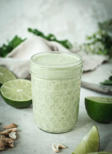 Lime crema in glass quilted jar with lime surrounding.