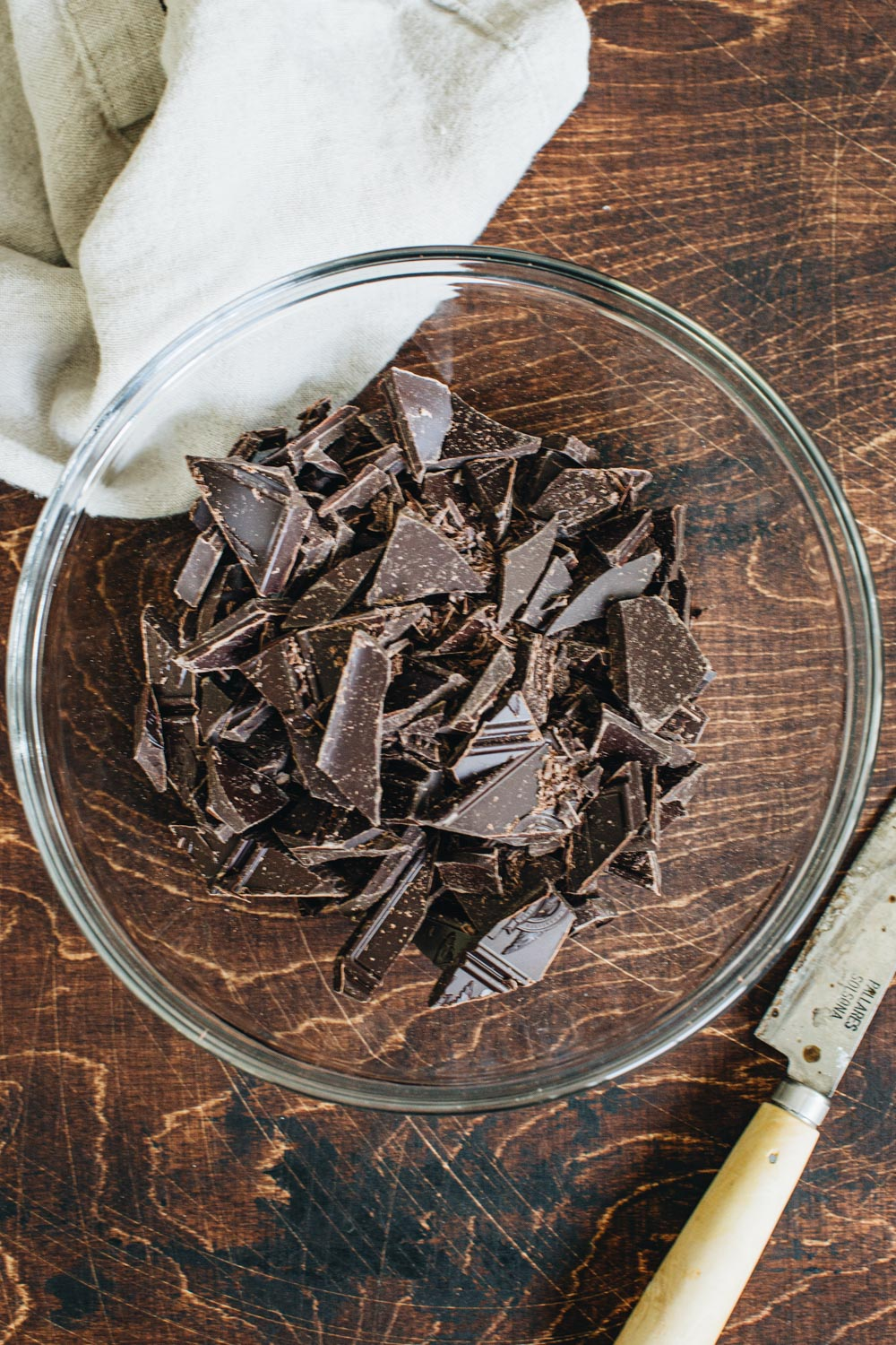 Chopped pieces of chocolate in a mixing bowl.