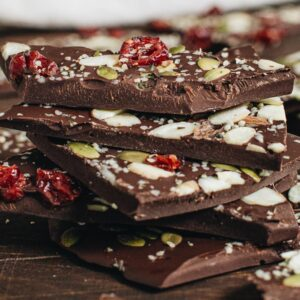 Stacked chocolate bark on wooden table.