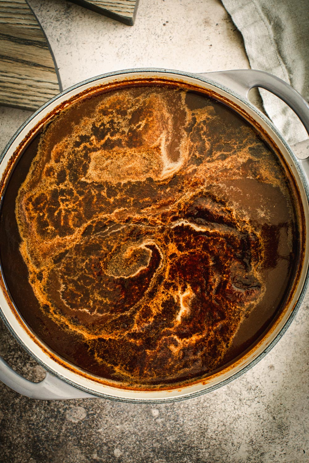 Barbecue sauce cooking in a large Dutch oven.