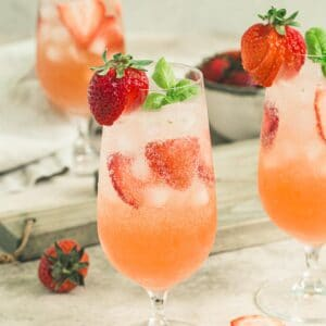 strawberry basil mojito topped with strawberries and fresh basil