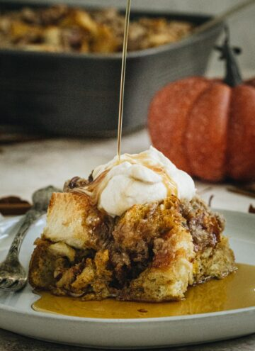 Pumpkin french toast casserole square on a white plate.