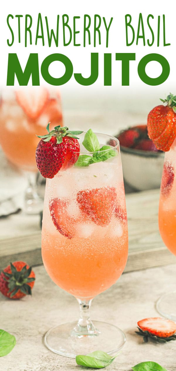 Strawberry basil mojito in a glass with fresh strawberry on the rim.