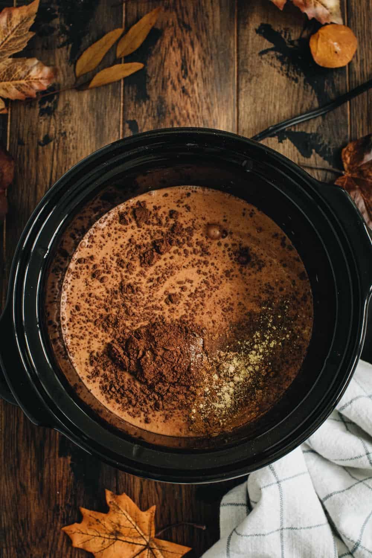 Pumpkin hot chocolate ingredients in a crockpot.