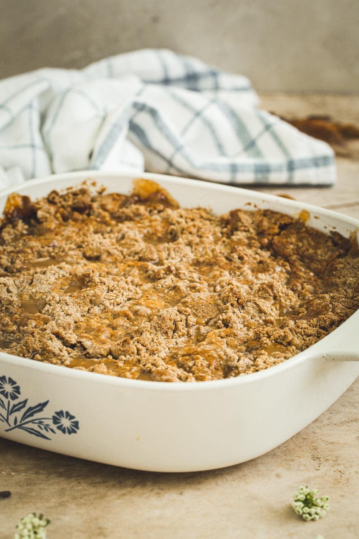 Caramel apple dump cake in a square baking dish.