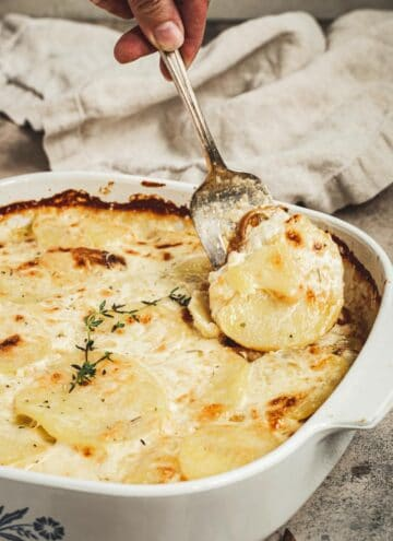 Easy scalloped potatoes with caramelized onions topped with fresh thyme.