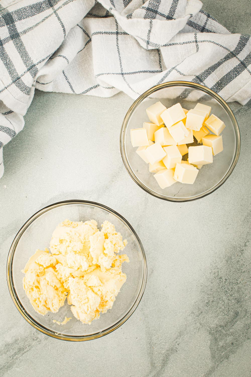 Cold butter cubes and shortening in small glass bowls.