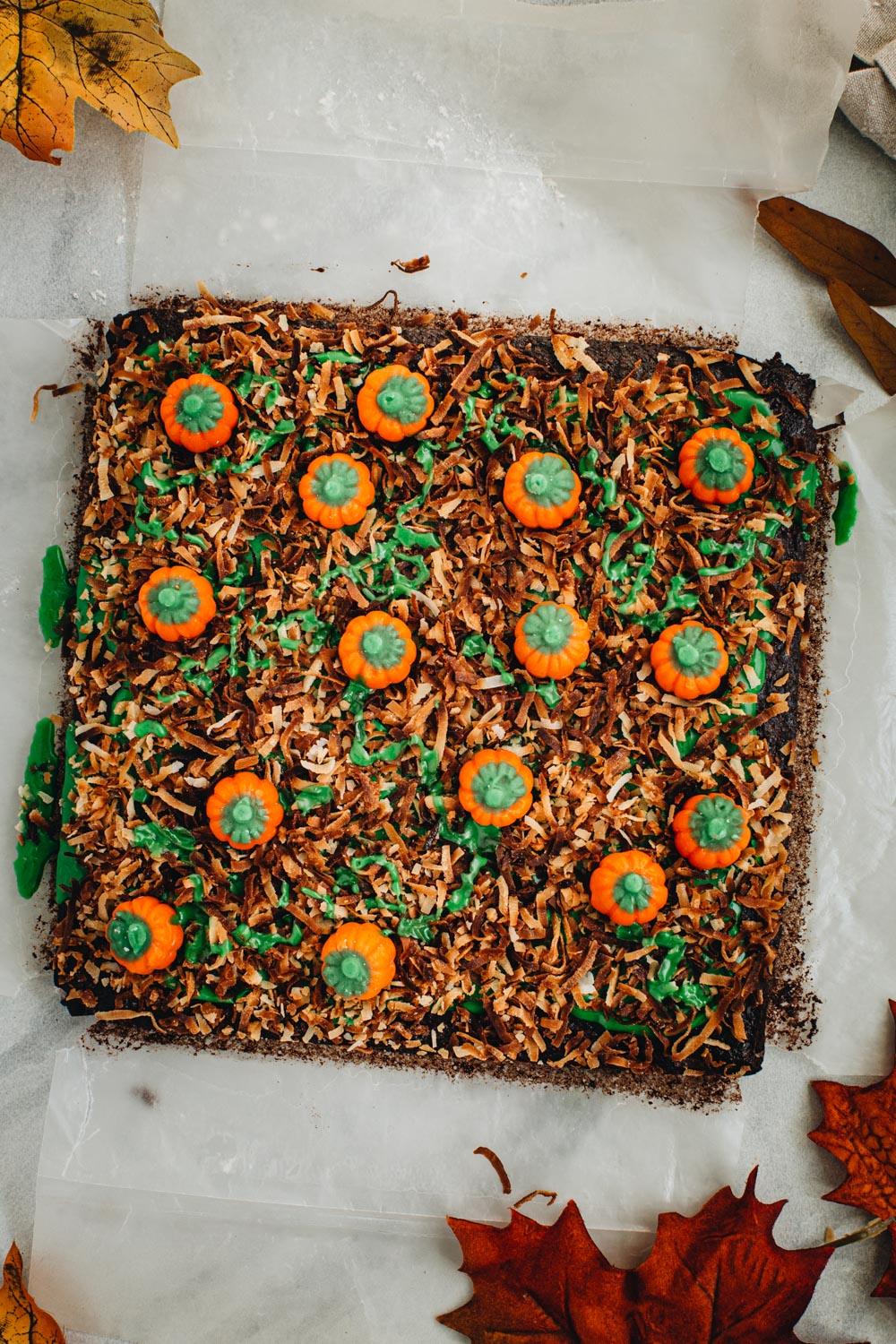 Pumpkin patch brownies topped with toasted coconut and pumpkin mellowcremes. Surrounded by fall leaves.