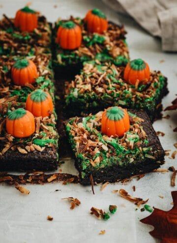 Sliced pumpkin patch brownies with mellowcreme pumpkins on top.