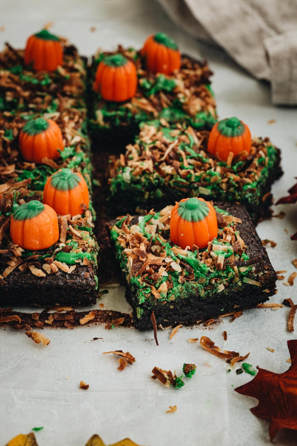 Sliced pumpkin patch brownies with mellowcreme pumpkins on top.