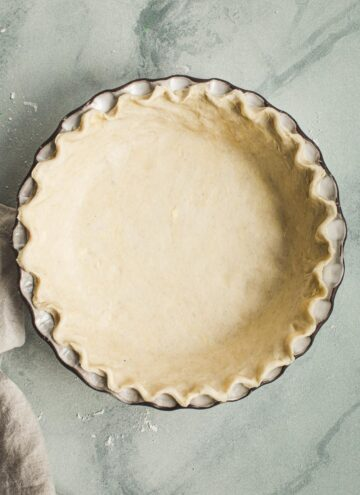Unbaked pie shell in a pie dish.