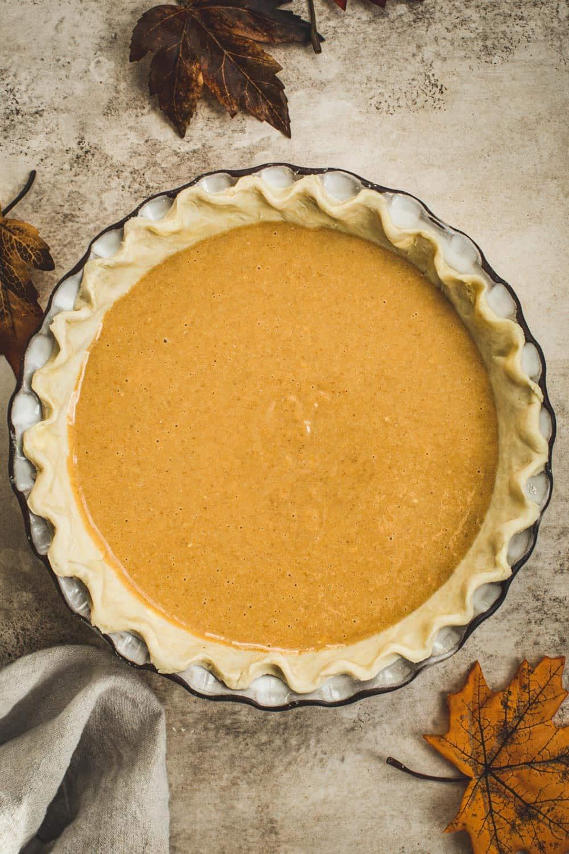 Unbaked maple pumpkin pie in a pie dish.