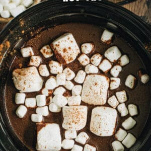 Slow cooker pumpkin hot chocolate topped with marshmallows image with title for Pinterest.