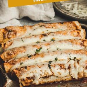 Butternut Squash Enchiladas on a rimmed baking sheet Pinterest image with white title.
