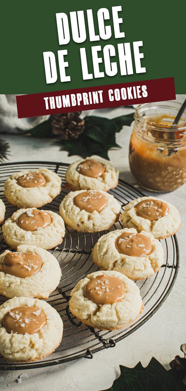 Thumbprint cookies on a wire rack with red and green title for Pinterest.
