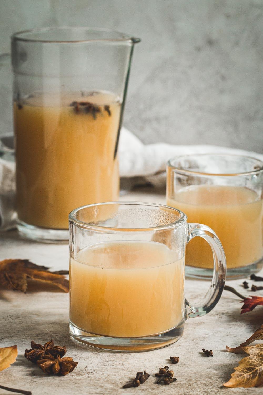 Caramel Bourbon Apple Cider cocktail in a clear mug.