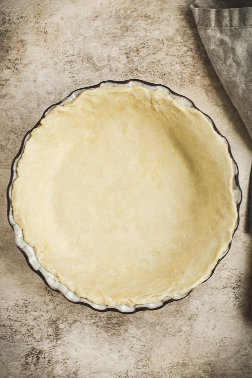 Unbaked pie shell in pie dish.