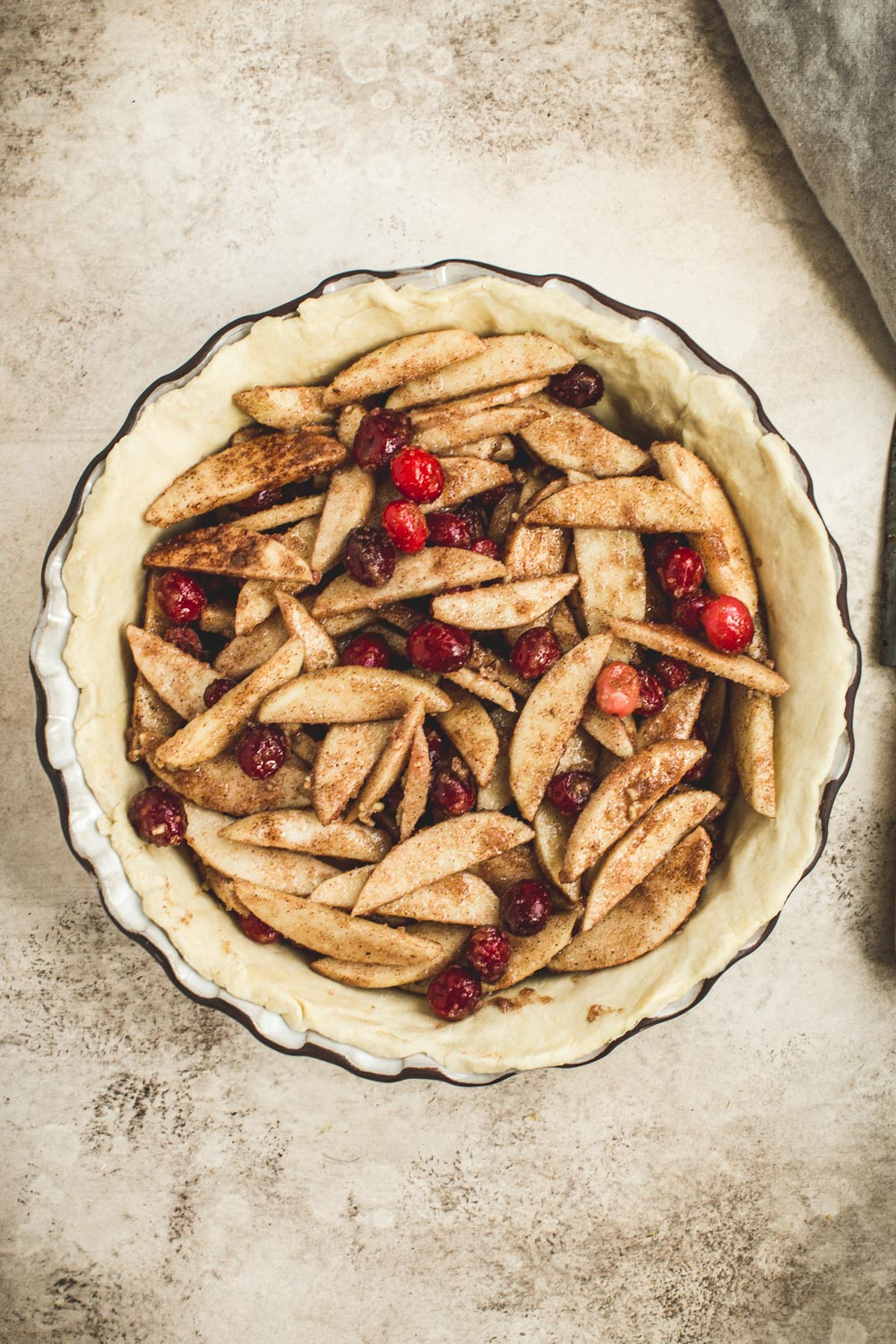 Apple and cranberry filling in a pie shell.