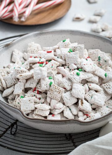 Peppermint puppy chow in a white pottery bowl.